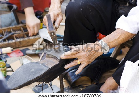 Shoe repair on street in Chinatown in Manhattan