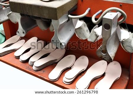 Shoe soles in a shoe factory. - stock photo