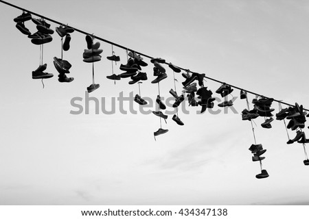 Shoe tossing - stock photo