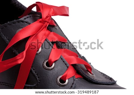 Shoe with red laces