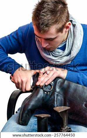 Shoemaker repairing a heel - stock photo
