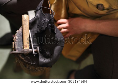 Shoemaker sews shoes.Shoemaker performs shoes in the studio craft - stock photo