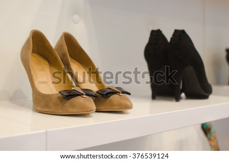 Shoes and accesorries in a retail store.