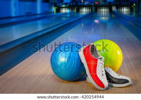 shoes and balls for bowling game - stock photo