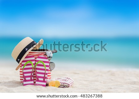 shoes and hat on the beach