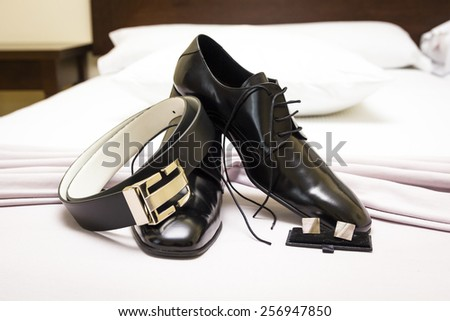 Shoes, belts and cuff links - stock photo