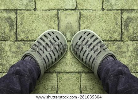Shoes dirty cement floor corridor - stock photo