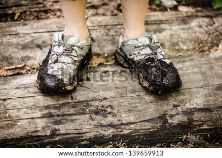 Shoes dirty with mud and water