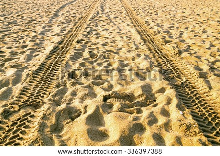 Shoes footprint shoe imprints and trace tyre sand - stock photo