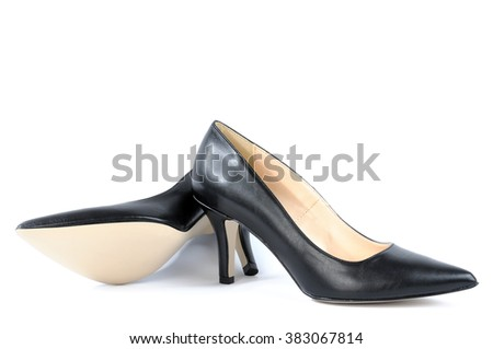 Shoes for women with high heel of black color photographed on white background.