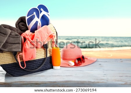 shoes of blue color and pink hat with glasses on blue desk space