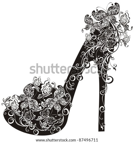 Shoes on a high heel decorated with flowers and butterflies - stock photo