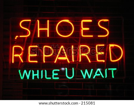 shoes repaired neon sign