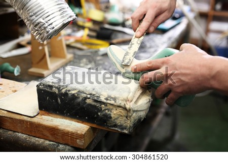 Shoes sewn with a cobbler .Shoemaker sews shoes - stock photo