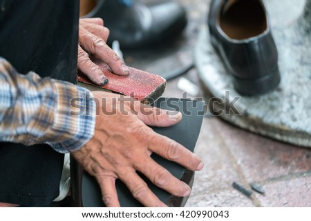 shoesmaker changing shoes soles