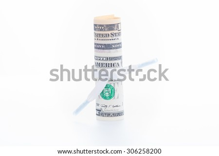 Shoestring budget concept with US dollar banknotes close up - stock photo