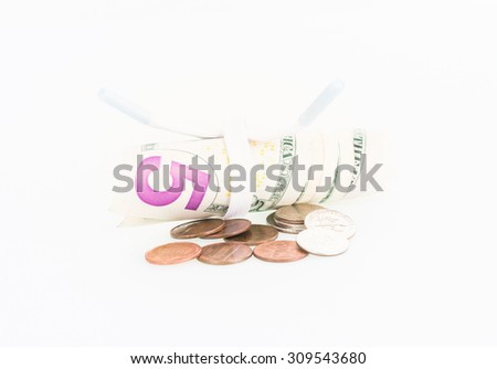 Shoestring budget concept with US dollars and coins over white background - stock photo