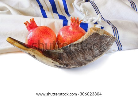 shofar (horn), white prayer talit and pomegranate isolated on white. rosh hashanah (jewish holiday) concept . traditional holiday symbol. - stock photo
