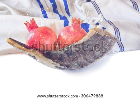 shofar (horn), white prayer talit and pomegranate isolated on white. rosh hashanah (jewish holiday) concept . traditional holiday symbol. glitter overlay - stock photo
