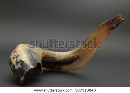 shofar ( ram horn ) isolated over black background - rosh hashanah (jewesh holiday) concept - stock photo