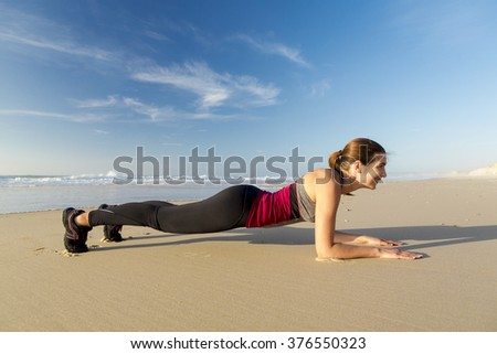 Shoot of a beautiful woman exercising herself in the beach