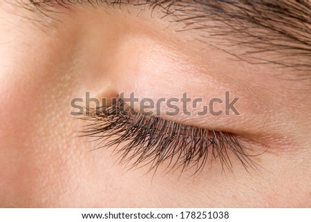 shoot of beautiful teenager man closed eye macro
