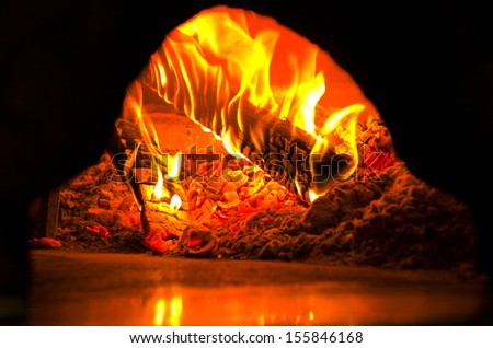 shoot of fire in a pizza oven   - stock photo