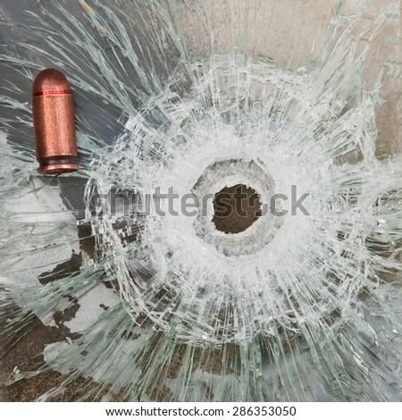 shoot through bulletproof glass - stock photo