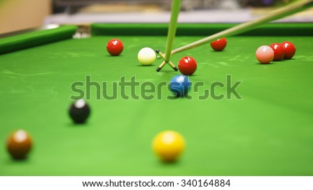 Shoot white ball snooker with rest stick. - stock photo