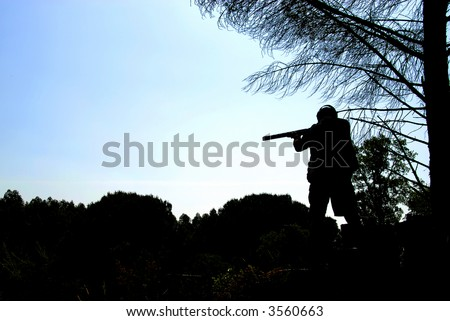 Shooter training - shotgun events - trap, in against light - stock photo