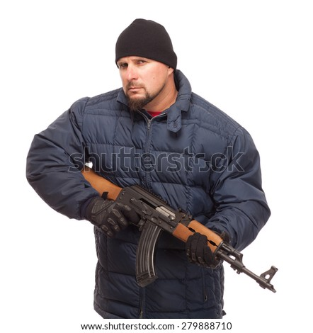 Shooter with AK 47 and cold weather gear ready to fight while looking at the camera on white background. - stock photo