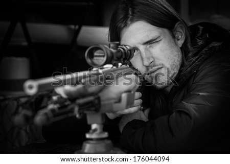 Shooting a rifle with a scope in Oregon. - stock photo