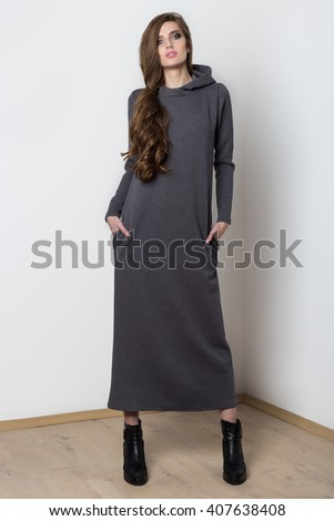 Shooting fashion dresses with beautiful sexy girl with long to catalog - stock photo