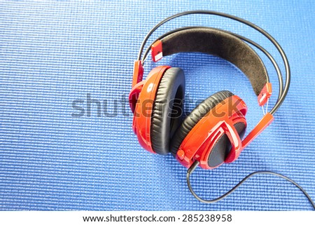 Shooting Headphone isolated on blue background