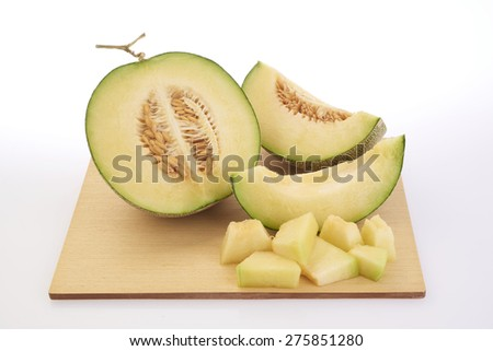 shooting melon fruit on cutting wooden board - stock photo