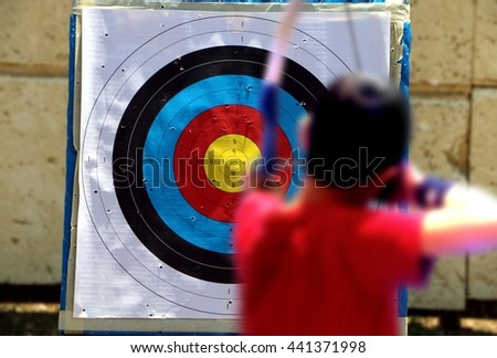 Shooting on a target during an archery competition - stock photo