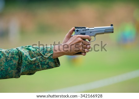 Shooting sports , female athletes ( Military) during shooting . The woman in the competition target shooting . (AARM 2015)  - stock photo