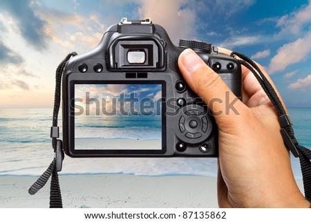 Shooting sunrise at Caribbean Sea on DSLR camera - stock photo