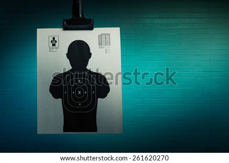 Shooting target hanging on a grungy background - stock photo