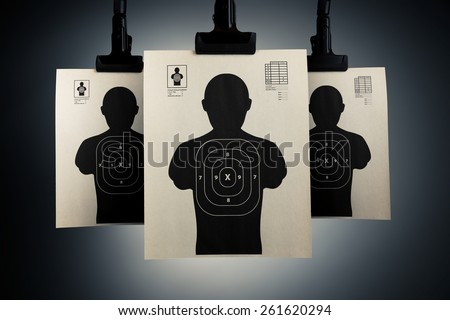 Shooting targets hanging on a grey background - stock photo
