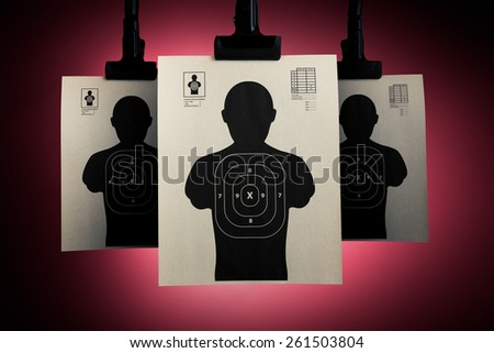 Shooting targets hanging on a red background - stock photo