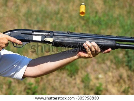 Shooting with a gun - stock photo