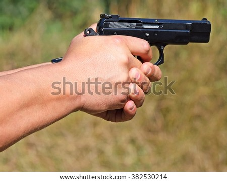 Shooting with a handgun - stock photo