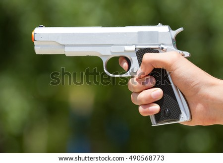 Shooting with a pistol in outdoor