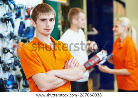 shop assistant seller in supermarket store - stock photo