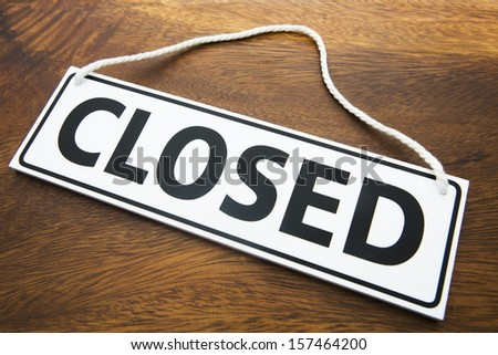 Shop Closed Sign On Wooden Background - stock photo