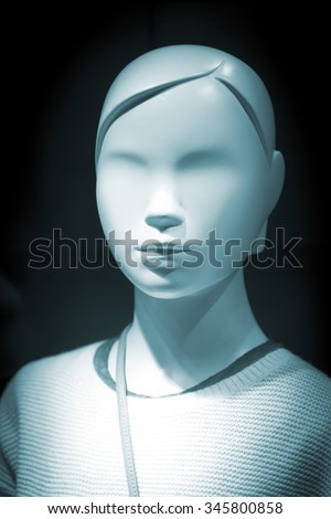 Shop dummy fashion child mannequin in store boutique shop window artistic photo. - stock photo