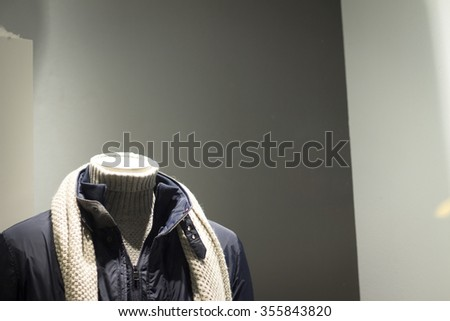 Shop dummy fashion mannequin in department store boutique window wearing current casual fashions in clothes. - stock photo