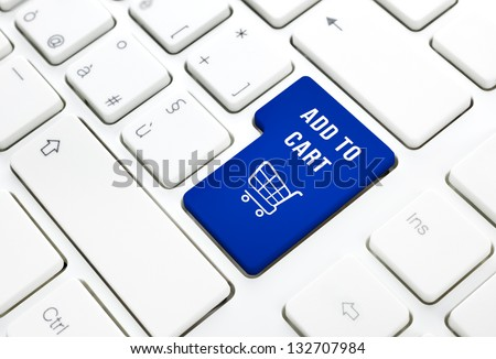 Shop on line add to cart business concept, Blue shopping cart button or key on white keyboard photography. - stock photo