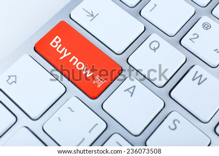 Shop online business concept. Close up of Buy now keyboard button - stock photo